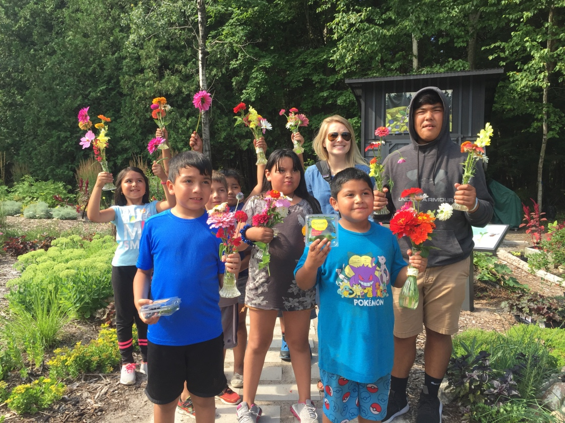 kids with flower bouquets